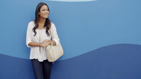Stylish-Cool-Girl-Against-A-Blue-Wall