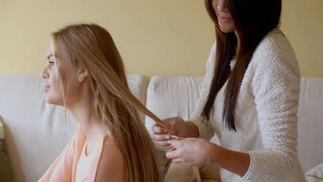Pretty-Woman-with-a-Friend-Fixing-her-Blond-Hair