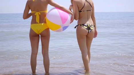 Shapely-bodies-of-two-girls-with-a-beach-ball