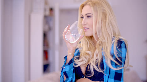 Woman-in-Blue-Bra-and-Open-Shirt-Drinking-Water