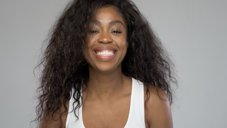 Happy-black-woman-laughing-for-camera