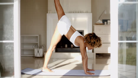 Woman-Leaning-Forward-In-Yoga-Pose