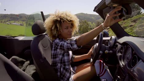 Young-Woman-Sitting-In-Cabriolet-
