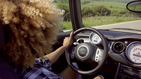 Young-woman-driving-her-cabriolet