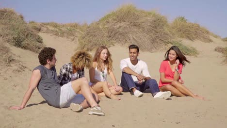 Young-People-Sitting-On-The-Beach-