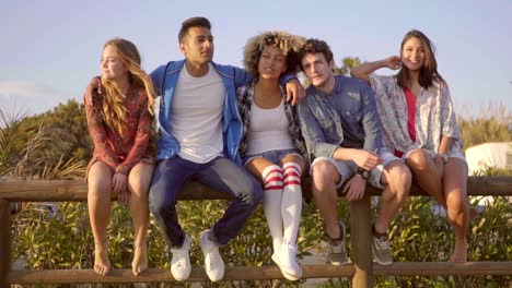 Young-People-On-Wooden-Fence-