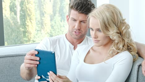 Happy-Couple-Using-Touch-Pad