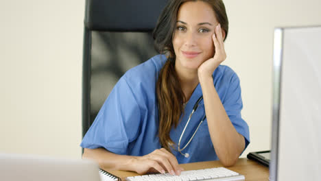 Serious-female-doctor-at-laptop-computer