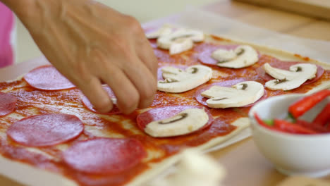 Woman-making-a-delicious-pepperoni-pizza