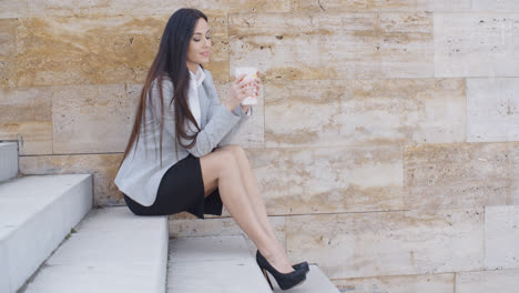 Business-woman-looking-at-coffee-cup