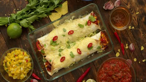 Homemade-Vegetable-Burritos-served-in-heatproof-dish-With-salsa-guacamole-nachos-and-ingredients