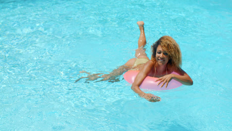 Young-Woman-Relaxing-in-Swimming-Pool