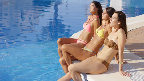 Three-sun-loving-young-women-in-bikinis