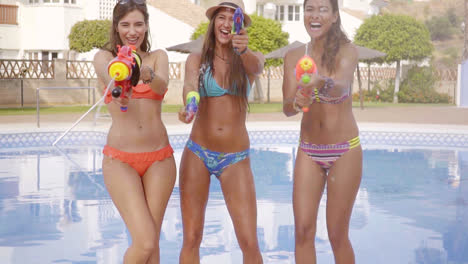 Three-sexy-girls-with-water-guns