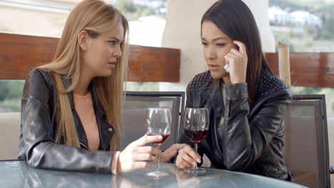 Female-drinking-with-crying-friend
