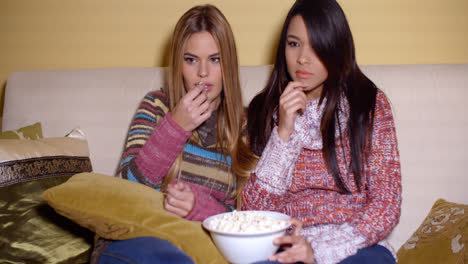 Frightened-Girls-Watching-Horror-Movie-at-Home