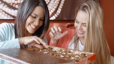 Two-pretty-women-eating-chocolates