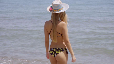 Young-woman-standing-gazing-out-over-the-ocean