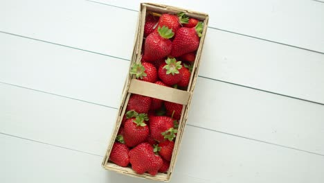 Fresh-healthy-strawberries-in-a-wooden-box-on-white-background-