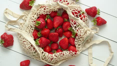 Fresh-strawberries-in-eco-friendly-package-on-white-wooden-background-Vegetarian-organic-meal