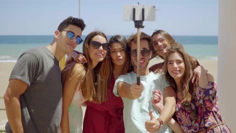 Group-of-young-friends-on-vacation-taking-a-selfie