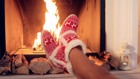 Young-woman-relaxing-in-Christmas-booties