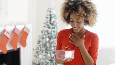 Excited-young-woman-with-an-unexpected-gift