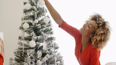 Attractive-woman-decorating-the-Xmas-tree