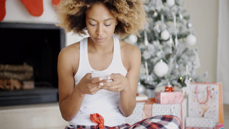 Serious-woman-checking-for-Christmas-messages