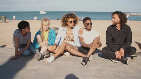 Lounging-young-friends-on-city-coastline