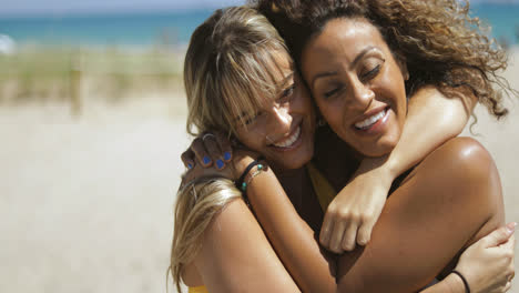 Embracing-happy-diverse-women-on-beach