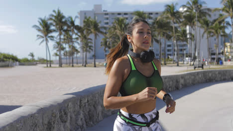 Fit-woman-exercising-and-running