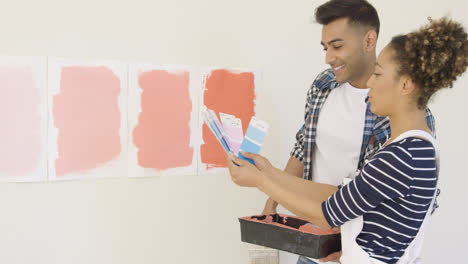 Young-couple-checking-paint-swatches