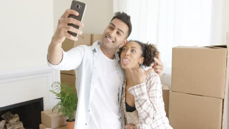Fun-young-couple-taking-their-selfie