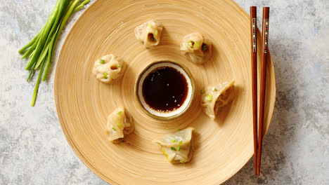 Delicious-chinese-dumplings-served-on-wooden-plate