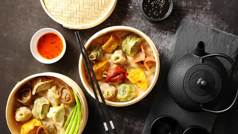 Composition-of-chinese-food-Mixed-kinds-of-dumplings-from-wooden-bamboo-steamer