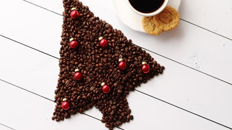 Beverage-and-cookies-near-Christmas-tree-from-coffee-beans