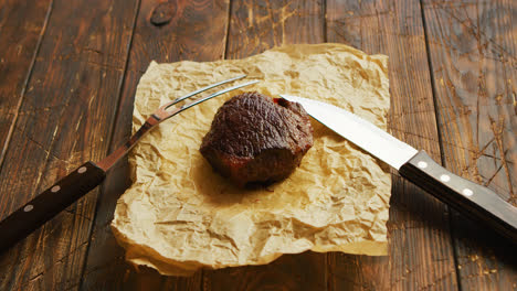 Fork-and-knife-near-roasted-meat