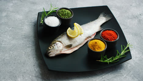 Spices-lying-on-plate-near-fish