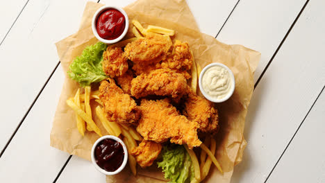 Sauces-and-lettuce-near-French-fries-and-chicken-wings