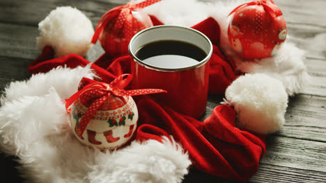 Christmas-hats-and-baubles-around-hot-drink
