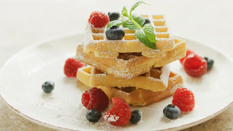 Waffles-served-on-plate-with-berries