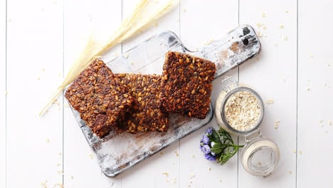 Closeup-of-whole-grain-bread-with-sunflower-seeds-on-a-rustic-wooden-board