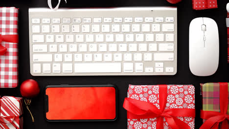 Computer-keyboard-modern-smartphone-mouse-and-christmas-boxed-gifts