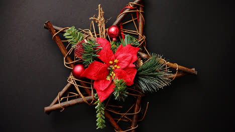 Christmas-wreath-with-dry-twigs-pine-branches-red-balls