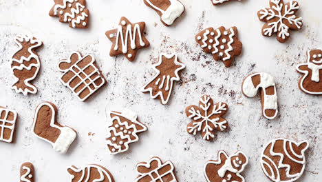 Composition-of-delicious-gingerbread-cookies-shaped-in-various-Christmas-symbols