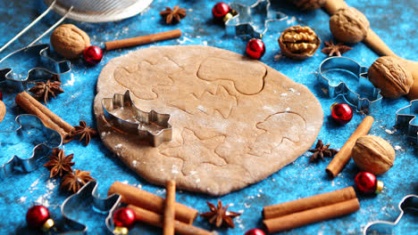 Christmas-baking-concept--Gingerbread-dough-with-different-cutter-shapes