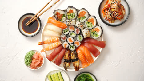 Various-sushi-rolls-placed-on-round-ceramic-plate