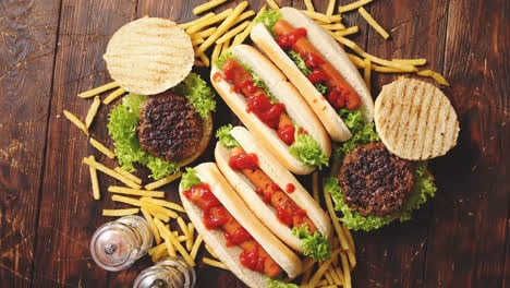 Fastfood-assortment-Hamburgers-and-hot-dogs-placed-on-rusty-wood-table