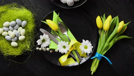 Easter-spring-table-dishware-composition-with-yellow-tulip-flower